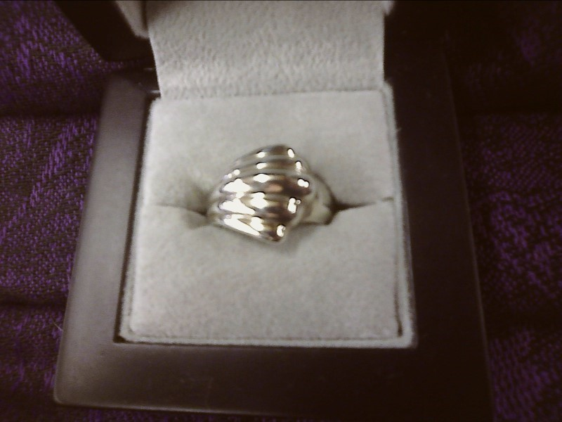 STERLING SILVER RING WITH LARGE WAVE DESIGN SIZE: 7