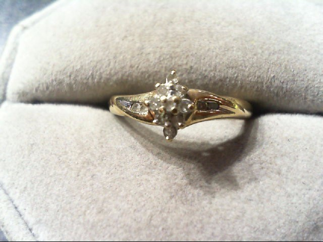 Lady's Diamond engagement Ring 9 Diamonds .09 Carat T.W. 10K Yellow Gold 2.1g