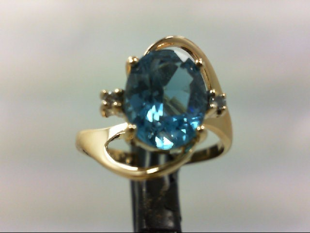 Blue Topaz Lady's Stone & Diamond Ring 2 Diamonds .02 Carat T.W.