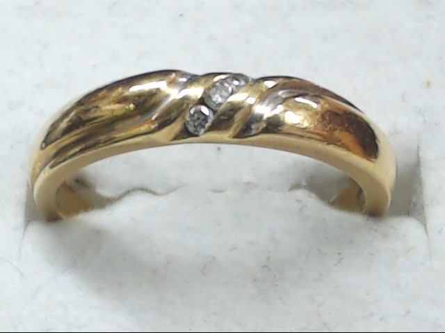 Lady's Diamond Wedding Band 3 Diamonds .03 Carat T.W. 14K Yellow Gold 2.5g