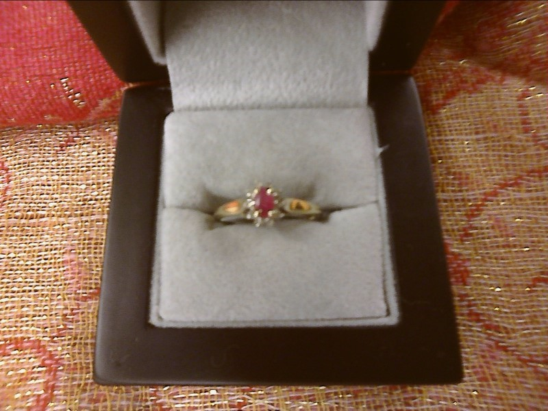 10K YELLOW GOLD RING-.20 OVAL RUBY W/ SMALL DIAMONDS AROUND SIZE: 7 1/2