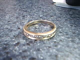 Gent's Gold-Diamond Wedding Band 15 Diamonds .15 Carat T.W. 14K Yellow Gold