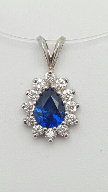 Gold-Diamond & sapphire Pendant 12 Diamonds .69 Carat T.W. 14K White Gold