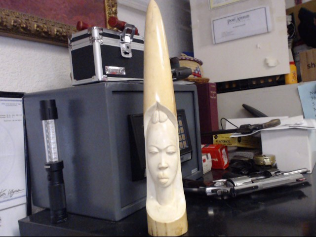 AFRICAN RELIEF CARVED IVORY TUSK OF A TRIBAL WOMAN.  CIRCA 1950