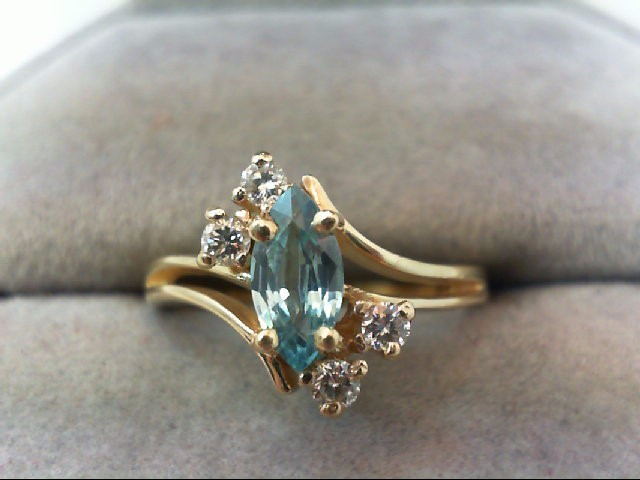 Blue Topaz Lady's Stone Ring 4 Diamonds .12 Carat T.W. 14K Yellow Gold 3.1g