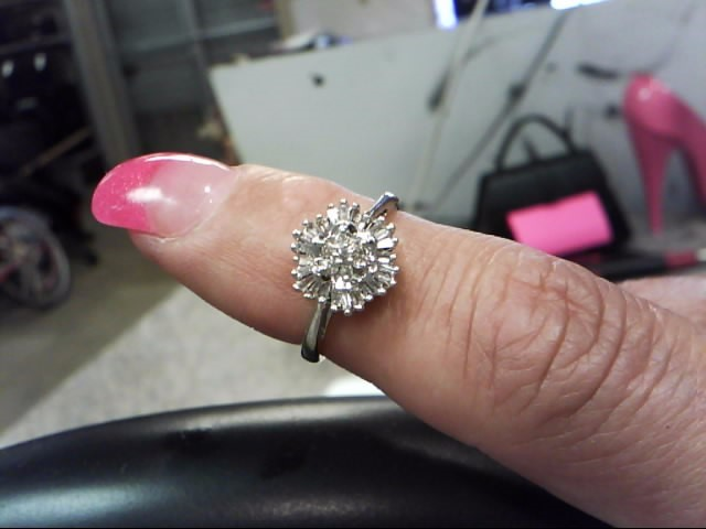 Lady's Diamond Cluster Ring 32 Diamonds .71 Carat T.W. 10K White Gold 1.45dwt