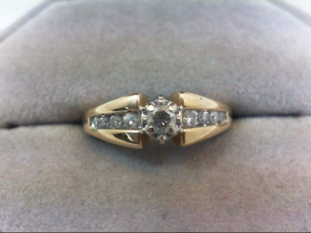 Lady's Diamond Engagement Ring 7 Diamonds .26 Carat T.W. 14K Yellow Gold 3.1g
