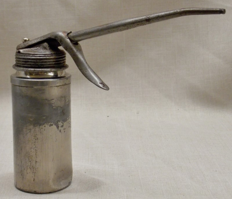 "PLEWS VINTAGE OIL CAN- MADE IN USA- HEIGHT 6"" - BASE 2"""
