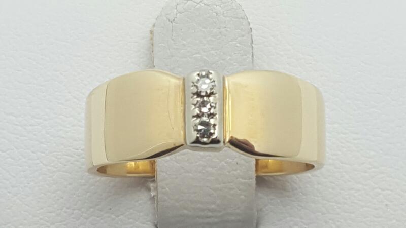 Lady's Diamond Fashion Ring 3 Diamonds .03 Carat T.W. 14K Yellow Gold 4.5g