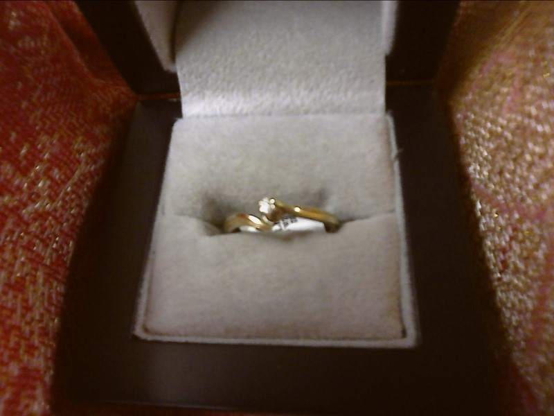 10K YELLOW GOLD SOLITAIRE RING WITH .05 CENTER DIAMOND SIZE: 6 1/2