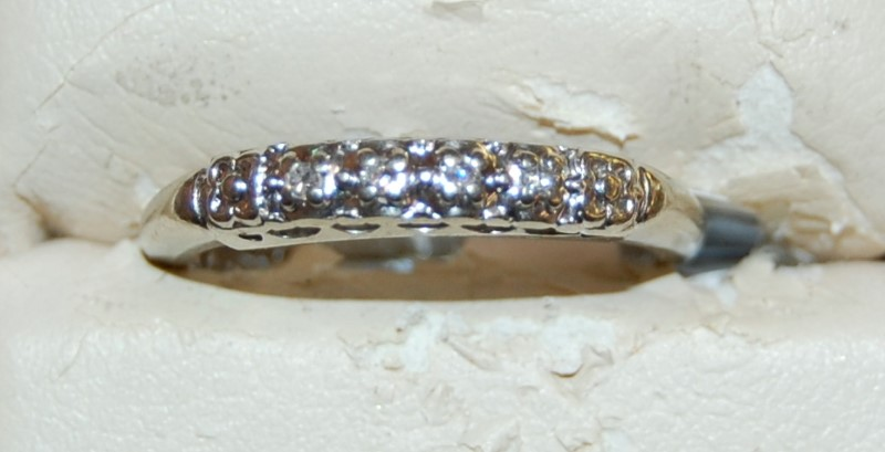 Lady's Diamond Wedding Band 4 Diamonds .04 Carat T.W. 10K White Gold 2.2g