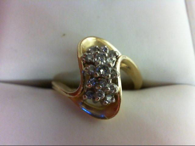 Lady's Diamond Cluster Ring 15 Diamonds .17 Carat T.W. 14K Yellow Gold 3.2g