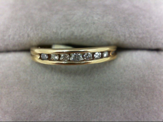 Lady's Diamond Wedding Band 7 Diamonds 0.15 Carat T.W. 10K Yellow Gold 1.4g Size