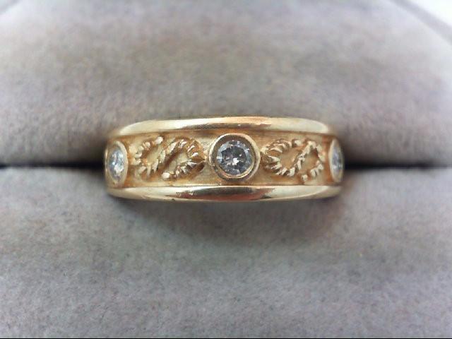Lady's Diamond Wedding Band 3 Diamonds .21 Carat T.W. 14K Yellow Gold 4.2g