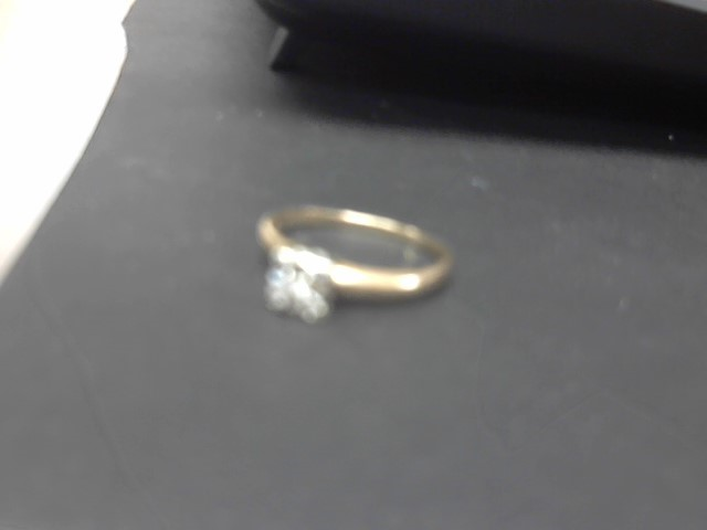 Lady's Diamond Fashion Ring .05 CT. 14K Yellow Gold 3.1g