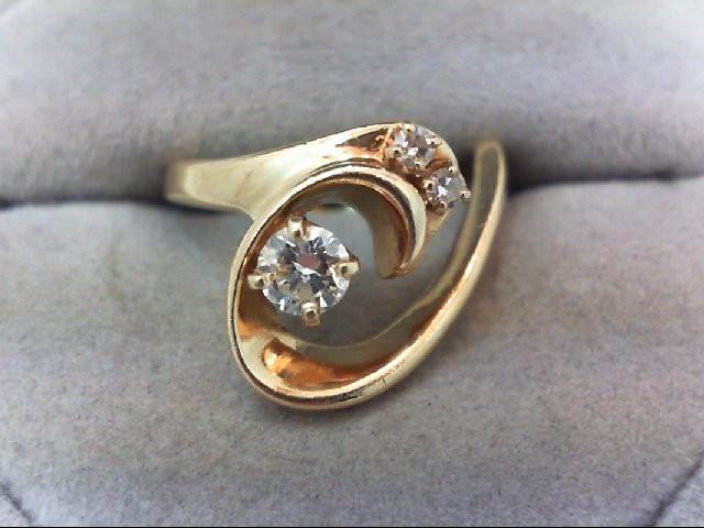 Lady's Diamond Fashion Ring 3 Diamonds .33 Carat T.W. 14K Yellow Gold 4.2g
