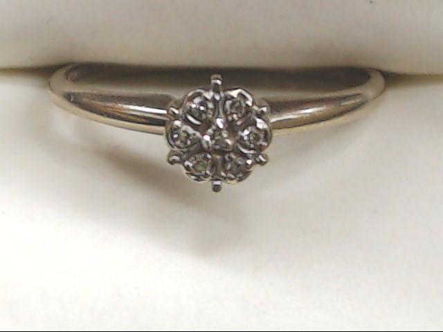 Lady's Diamond Cluster Ring 7 Diamonds .07 Carat T.W. 10K White Gold 1.9g