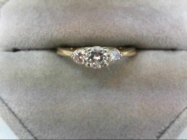 Lady's Diamond Fashion Ring 3 Diamonds 0.56 Carat T.W. 14K Yellow Gold 2.2g