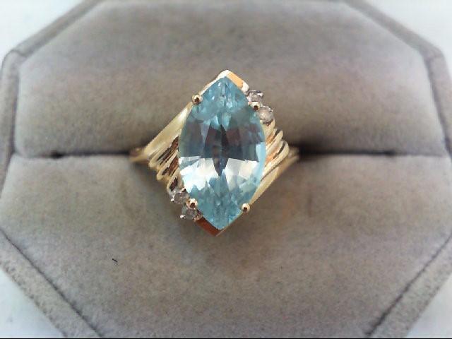 Blue Topaz Lady's Stone & Diamond Ring 4 Diamonds .04 Carat T.W.