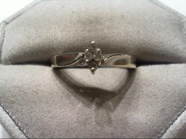Lady's Silver-Diamond Ring 4 Diamonds .12 Carat T.W. 925 Silver 3.4g