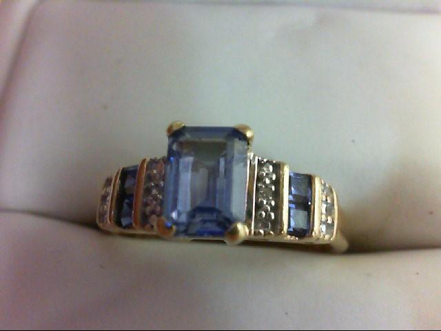 Synthetic Tanzanite Lady's Stone & Diamond Ring 6 Diamonds 0.06 Carat T.W. 10K Y