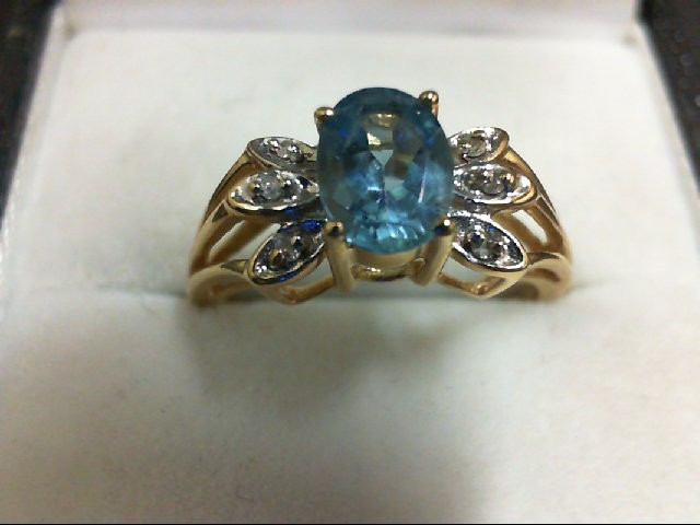 Blue Topaz Lady's Stone & Diamond Ring 2 Diamonds 0.02 Carat T.W. 14K Yellow Gol
