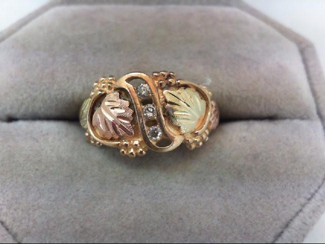 Lady's Diamond Fashion Ring 3 Diamonds .12 Carat T.W. 10K 2 Tone Gold 2.8g