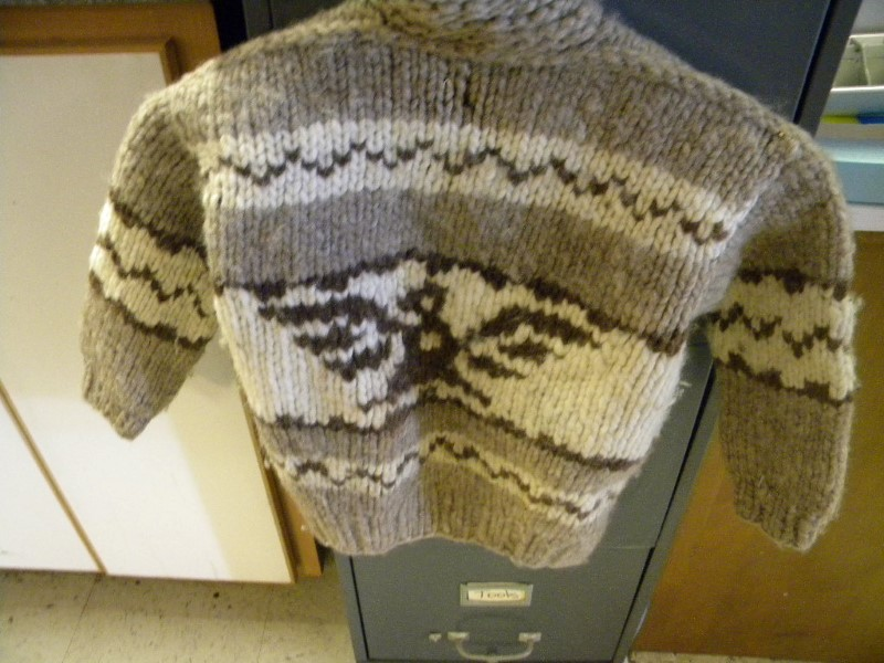 COWEGAN CHILDS SWEATER SMALL HOLE IN SLEEVE