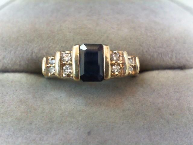 Sapphire Lady's Stone & Diamond Ring 8 Diamonds .12 Carat T.W. 14K Yellow Gold
