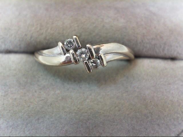 Lady's Diamond Wedding Band 3 Diamonds 0.09 Carat T.W. 10K White Gold 2.1g