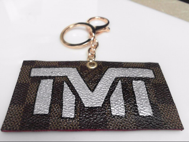 THE MONEY TEAM TMT KEY CHAIN ON DISTRESSED LV BAG CANVAS