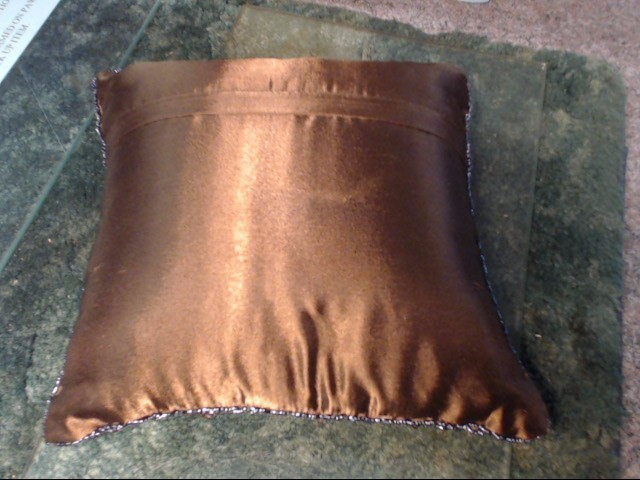 BRN SHELL COVERED PILLOW