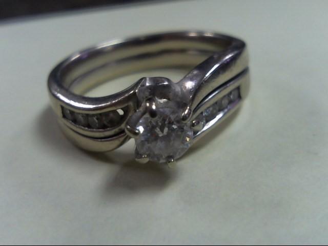 Lady's Diamond Wedding Band 9 Diamonds .57 Carat T.W. 14K White Gold 5.1g