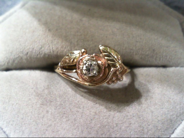 Lady's Diamond Fashion Ring .12 CT. 10K Tri-color Gold 1.8g