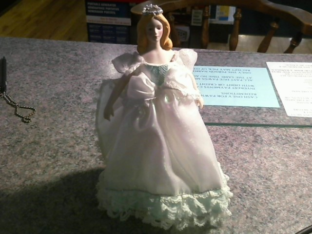 """PORCELAIN DOLL WITH HEAD DRESS, FAUX PEARL ACCENT.STANDS APPX 8"""" TALL."""