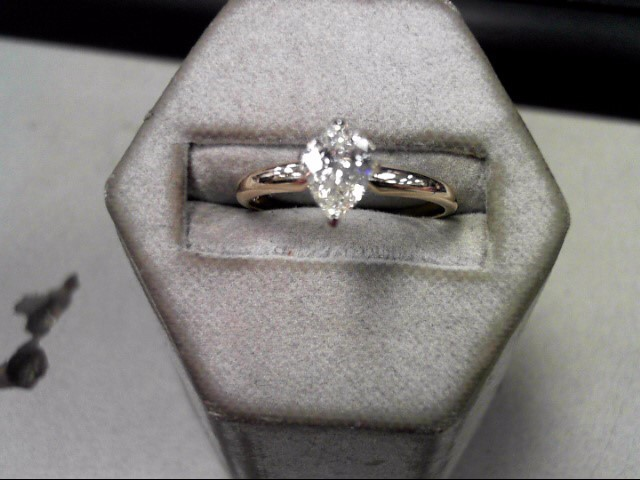 Lady's Diamond Solitaire Ring .72 CT. 14K Yellow Gold 2.22g Size:7