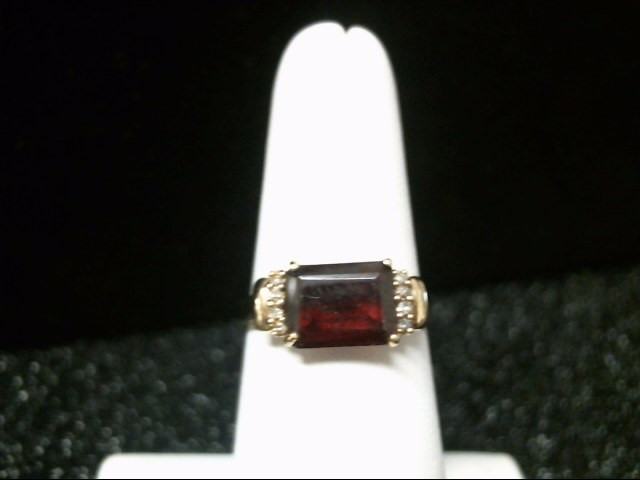 Red Stone Lady's Stone & Diamond Ring 6 Diamonds .06 Carat T.W. 10K Yellow Gold