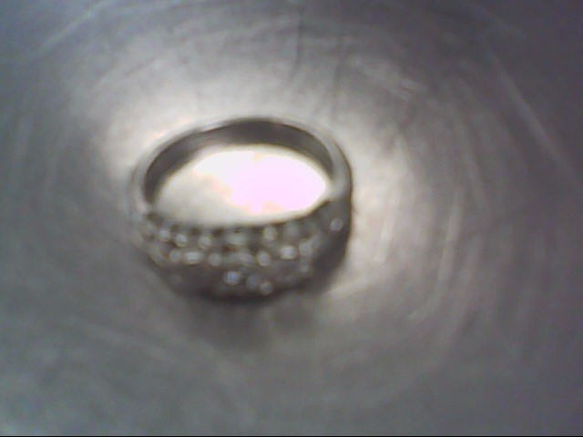 Lady's Silver-Diamond Ring 3 Diamonds .03 Carat T.W. 925 Silver 2.7g
