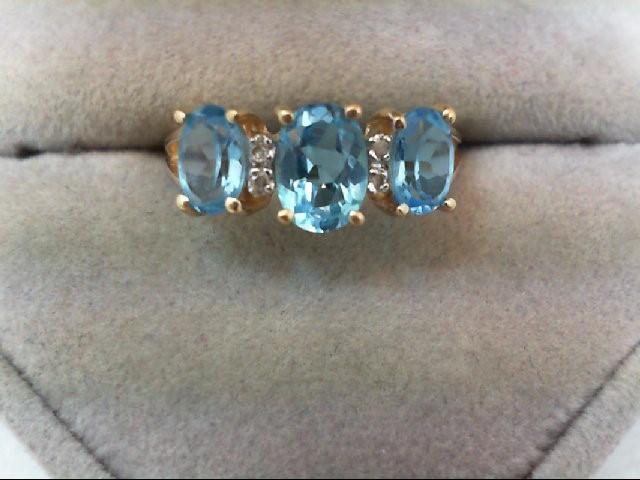 Blue Topaz Lady's Stone & Diamond Ring 4 Diamonds 0.04 Carat T.W. 14K Yellow Gol