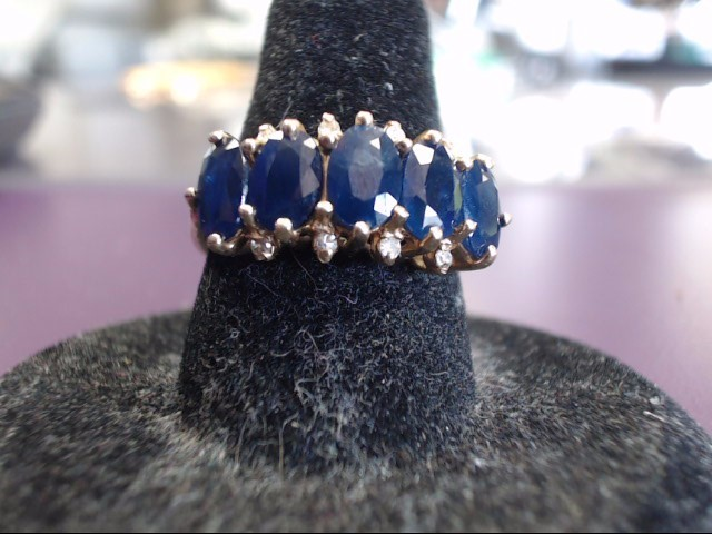 Sapphire Lady's Stone & Diamond Ring 8 Diamonds .08 Carat T.W. 10K Yellow Gold