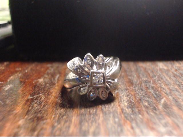 Lady's Diamond Cluster Ring 9 Diamonds .12 Carat T.W. 14K Yellow Gold 3.9g