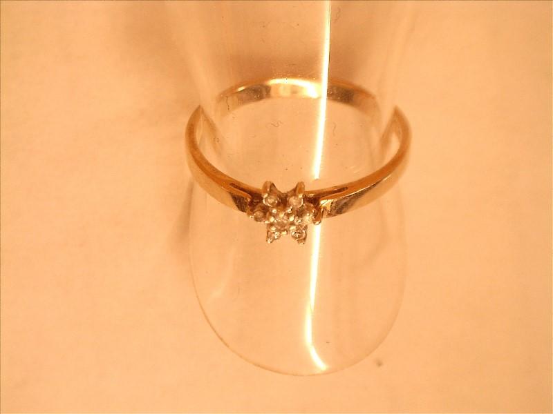 Lady's Diamond Cluster Ring 7 Diamonds .07 Carat T.W. 10K Yellow Gold 0.84dwt