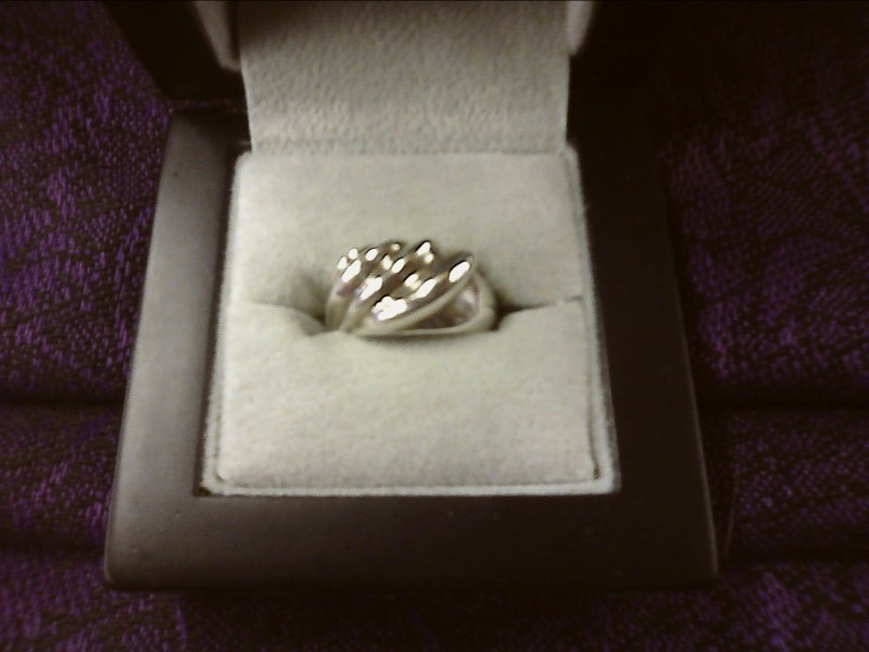 STERLING SILVER RING W/ WAVE DESIGN SIZE: 5 1/2