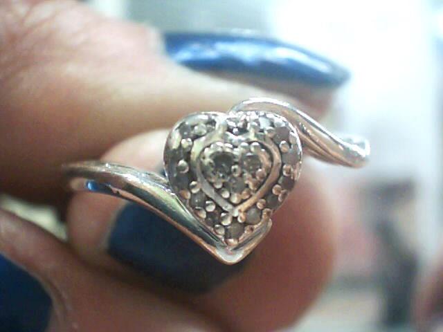 Lady's Silver-Diamond Ring 12 Diamonds .12 Carat T.W. 925 Silver 1.9dwt