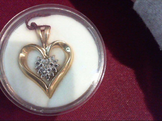 Gold-Diamond Solitaire Pendant .01 CT. 10K Yellow Gold 2.4g