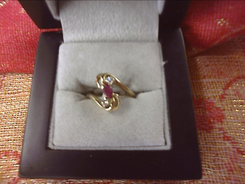 14K YELLOW GOLD RING -.15 OVAL RUBY & TWO SMALL DIAMONDS ON EITHER SIDE- SIZE: 5