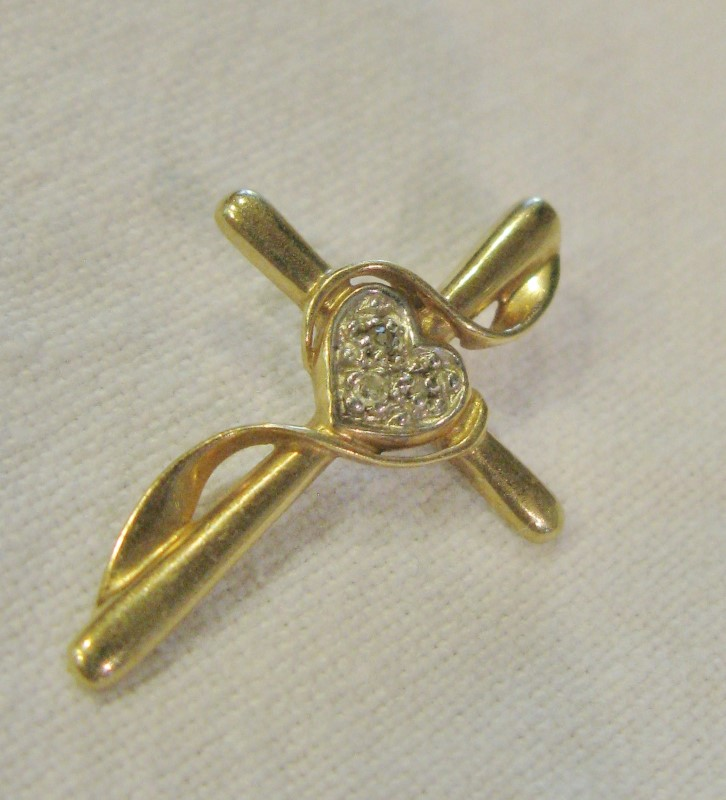 "1"" CROSS WRAPPED WITH A GOLD RIBBON PLUS A HEART & TINY SAPRKLING DIAMONDS 10K"