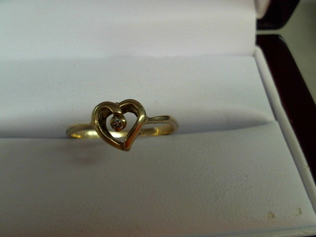 Lady's Diamond Solitaire Ring .03 CT. 10K Yellow Gold 1.6g