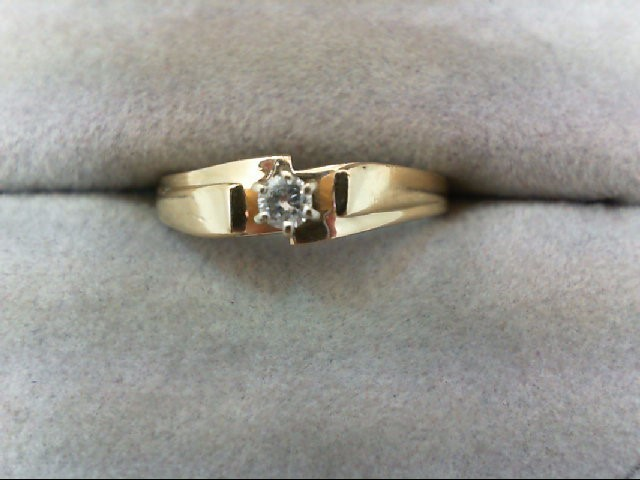 Lady's Diamond Solitaire Ring 0.08 CT. 10K Yellow Gold 1.9g