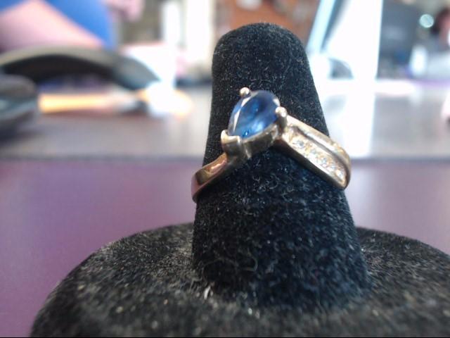 Tanzanite Lady's Stone & Diamond Ring 5 Diamonds .05 Carat T.W. 14K Yellow Gold